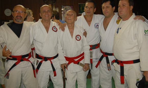 Master Manoel at his coral belt promotion with Helio, Relson, Rolker et. all.
