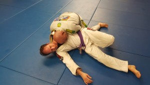 Robert comes up to his knees and finishes establishing side control.