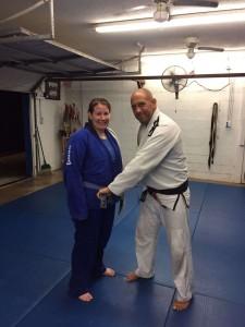 Megan receives her blue belt in Gracie Jiu-Jitsu from Master Victor Huber.