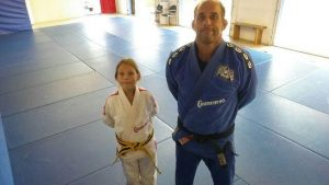 Victor Huber and his daughter Kayla at his academy in Atlantic Beach, FL