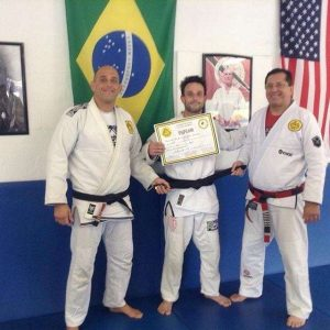 Joao promoted to black belt by Victor Huber and Rolker Gracie
